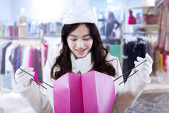 Girl look inside the shopping bag Stock Photography