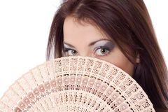 Girl look over fan fanteil Royalty Free Stock Images