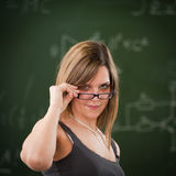 Girl looking above her reading glasses Royalty Free Stock Photography
