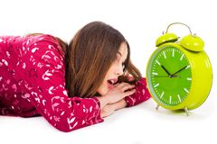 Girl looking into the alarm while its ringing Stock Image