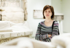 Girl looking ancient sculptures Royalty Free Stock Photography