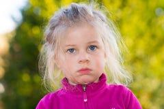 Girl looking ashamed stock photo