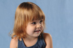 Girl looking aside with smile Royalty Free Stock Photography