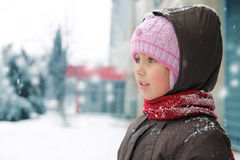 Girl looking aside in winter cloths Royalty Free Stock Photography