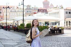 Free Girl Looking At The Map Standing At The Main Square Stock Image - 181216151
