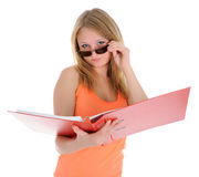The girl looking atop of glasses Stock Photography
