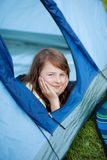 Girl Looking Away While Lying In Tent Stock Images