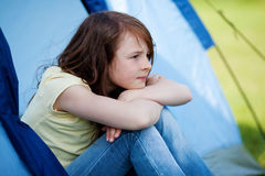Girl Looking Away While Sitting In Tent Stock Photos