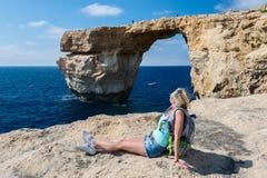 Girl looking on Azure Window formation on Gozo Island Stock Image