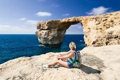 Girl looking on Azure Window on Gozo Island Stock Photos