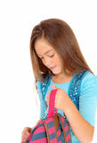 Girl looking in backpack. Royalty Free Stock Photography