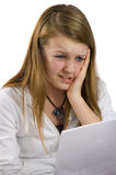 Girl looking at bad results. Girl holding paper with unhappy expresion Royalty Free Stock Photography