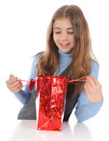 Girl looking in bag Stock Images