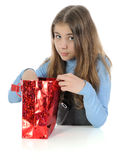 Girl looking in bag Royalty Free Stock Photos