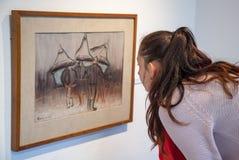Girl looking at Bazovsky's painting, Slovakia royalty free stock photography