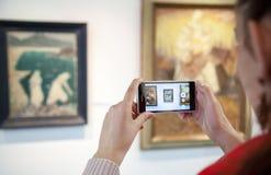 Girl looking at Bazovsky's painting, Slovakia royalty free stock image