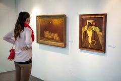 Girl looking at Bazovsky's painting, Slovakia royalty free stock photo