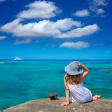 Girl looking at beach in Formentera turquoise Mediterranean Royalty Free Stock Images