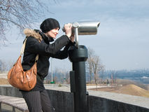 Girl looking in binocular Royalty Free Stock Image