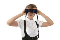 The girl looking in the binocular Royalty Free Stock Photo