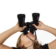 Girl looking through binoculars Stock Images