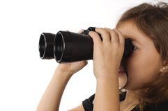 Girl looking through binoculars Stock Photo