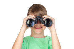 Girl looking through binoculars Stock Images