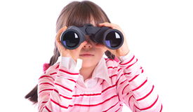 Girl looking in binoculars Royalty Free Stock Photo