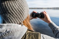 A girl is looking through binoculars Stock Image