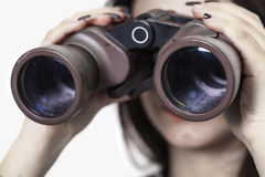 Girl looking through binoculars Stock Image