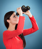 Girl looking through the binoculars Royalty Free Stock Photo