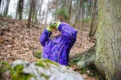 Girl looking through the binoculars Royalty Free Stock Photo