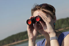 Girl looking through binoculars Royalty Free Stock Photo