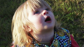 Girl looking at birds. In sandbox girl looks up at birds singing stock video footage