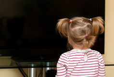 Girl looking at blank tv Royalty Free Stock Photo