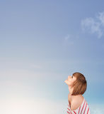 Girl looking at the blue sky copyspace Stock Photography