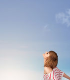 Girl looking at the blue sky copyspace Royalty Free Stock Images