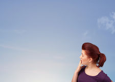 Girl looking at the blue sky copyspace Stock Photo