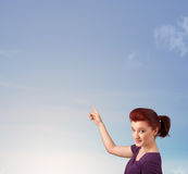 Girl looking at the blue sky copyspace Royalty Free Stock Photography