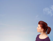 Girl looking at the blue sky copyspace Royalty Free Stock Photo