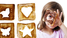 Girl looking through  bread with chocolate  butter Stock Image