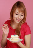 Girl looking at cake Royalty Free Stock Photography