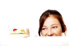 Girl looking at the cake. Stock Photos