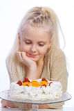 Girl looking at cake Stock Photos