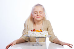 Girl looking at cake Royalty Free Stock Photos