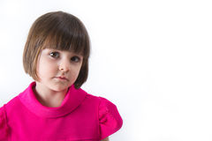 Girl looking at the camera. Little girl, looking focused at the camera. Studio shot Stock Photos