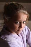 Girl looking at camera. A sad looking girl looking straight at the camera with big blue eyes Royalty Free Stock Photos