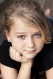 Girl looking at camera. Young beautiful girl with a smile looking at camera Royalty Free Stock Images