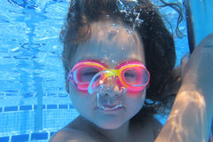Girl looking at camera underwater Stock Images