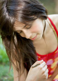 Girl Looking at Caterpillar on Hand Stock Photography